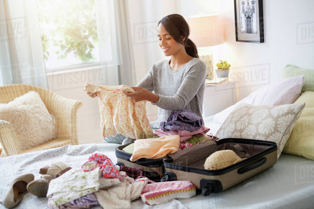 travel hacks for parents woman packing